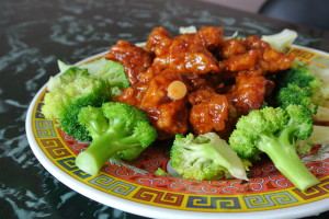 General Tso's Chicken is spicy, crispy, and served with steamed broccoli.